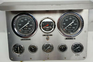 Fire truck stainless steel dash panel with cool gauges and Faria 5,000 RPM tach