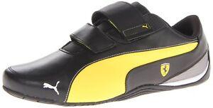 PUMA Men's Drift Cat 5 Ferrari AC NM Motorsport Shoe,Black/Vibrant Yellow Retro