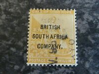 BRITISH SOUTH AFRICA Co. RHODESIA POSTAGE STAMP SG64 1 SHILLING YELLOW FINE USED