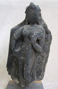 ANCIENT GANDHARAN SCHIST STONE SCULPTURE OF A FEMALE DEITY, circa 200 AD