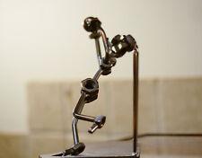 metal industrial style footballer figurine