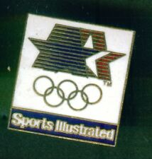 LOS ANGELES 1984  OLYMPIC GAMES. SPONSOR PIN/BADGE. SPORTS ILLUSTRATED. WHITE