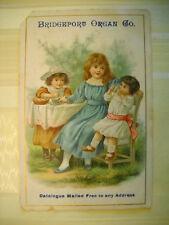 BRIDGEPORT ORGAN CO Victorian trade card CHROMO 3 girls have tea BRIDGEPORT CONN