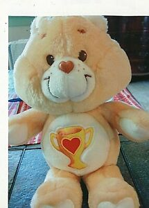 "1985 Vintage Plush Stuffed Care Bear of Champ bear. 12"" tall."