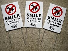 "3 NO DOG POOP - SMILE YOU'RE ON CAMERA  8""X12"" Plastic Coroplast Signs w/Stakes"