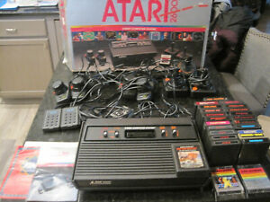 Atari  2600 game with lots of extras and 24 games looks new