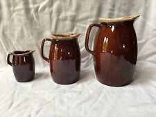 New ListingHull lot of 3 pitchers brown dip patterned pottery