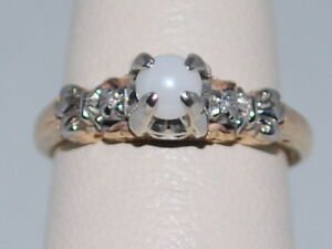 14k Gold ring with a Pearl(June birthstone) and diamonds in a beautiful design