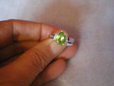 Peridot & Topaz ring, 2.03 carats, size N/O, in 3.83 grams of 925 Sterling Silve