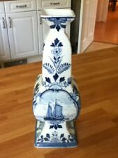 blue and white delft vase with boats
