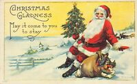 Christmas Postcard Santa Claus Sitting In The Snow Tree and Bag of Toys~125574