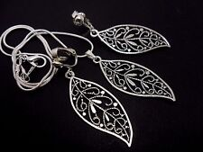 A TIBETAN SILVER  LEAF THEMED NECKLACE AND CLIP ON EARRING SET. NEW.