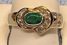 LADIES OVAL SHAPED EMERALD + DIAMOND RING, SET IN 14K YELLOW GOLD $1200.00