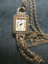 "GENEVA SILVER TONE RECTANGLE WATCH ON ROPE STYLED 30""-CHAIN RUNS GOOD"