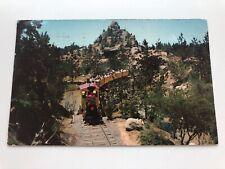 Vintage DISNEYLAND Postcard--Frontierland--The Mine Train Passing Bobcat View CA