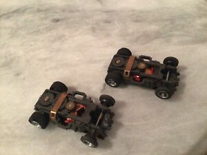 2- VINTAGE HO SCALE SLOT CAR CHASSIS