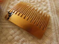 ancien peigne vintage doré motif noir  combs jamais utilisé