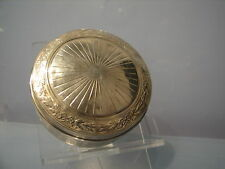 A french magnificent circular silver box with detailed guilloching of the silver