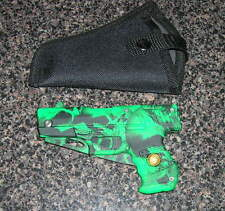 SKULL GREEN CAMO FOLDING GUN KNIFE WITH BELT CLIP AND A CASE TOO