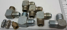 Assortment of steel AN on one end and pipe thread on the other end fittings