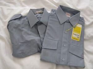 Two nylon or terylene uniform shirts: blue 14.5