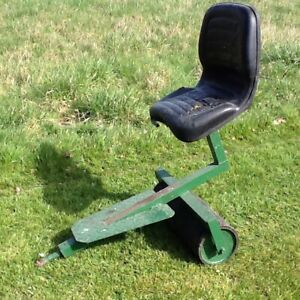 Lawnmower trailing roller and seat