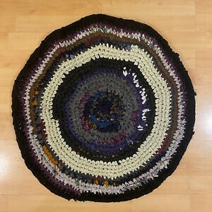 Handmade round braided knitted rug - recycled cotton yarn
