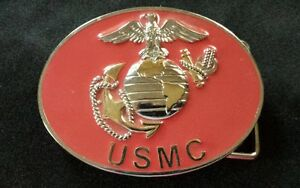 UNITED STATES MARINES GOLD TONED EMBLEM BELT BUCKLE RED OVAL BACKGROUND