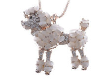 Cute Golden Rhinestone Encrusted Poodle Necklace With Peach Hued Stone Accents