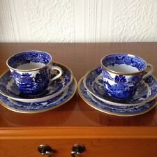 TWO ANTIQUE WILLOW PATTERN TRIO'S. CUP, SAUCER & PLATE