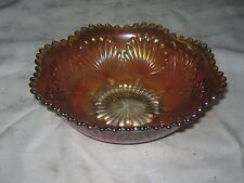 A Serrated Edged Marigold Carnival Glass Scallop Seashell Patterned Nappy Bowl