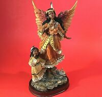 """INDIAN ANGEL FIGURINE WATCHING OVER CHILD 10 1/2"""" PLAYING HORN VINTAGE WOOD BASE"""