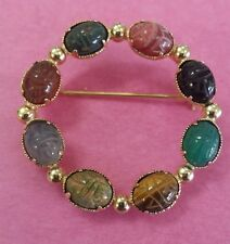 Vintage Egyptian brooch of carved scarab beetles on Gemstones 12Kgf.Made By Ron