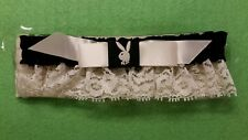 Play boy garter black/white with white lace unused