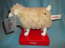 FAO SCHWARZ  PLUSH LAMB  WITH TAGS. DATED C) 2011  ALSO HAS BRAND TAG ON REAR.