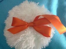 Plush Shaggy body powder puff with orange loop handle and bow, 6 inches