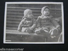 Vintage 1942 Black and White Photo of Two Toddlers Sitting on a Bench
