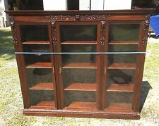 Triple Door Carved Griffin Mahogany Bookcase, Attr. R.J. Horner