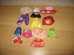 job lot of fashion dolls outfits .