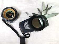 Schrade Touch camping tool compass mirror red light, belt hook, whistle.