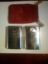 Two Vintage Jon-E Hand Warmers One 1976, One 1960's
