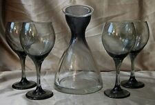 CLEAR and SMOKED GLASS COVERED CARAFE with FOUR SMOKED GLASS WINE GOBLETS