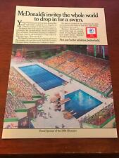1984 VINTAGE 8X11 PRINT Ad FOR McDONALD'S LA OLYMPIC SWIM STADIUM INVITES WORLD