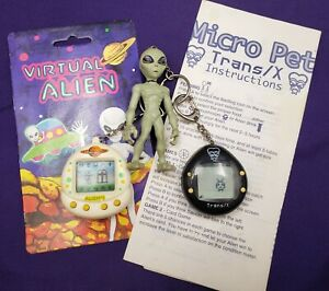 Lot of 2 Virtual Alien & Micro Pet Trans/X Alien Instructions Tested/Works 1997