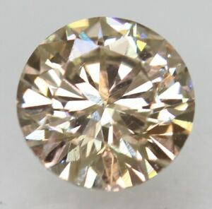Cert 0.62 Carat Light Brown VVS1 Round Brilliant Enhanced Natural Diamond 5.49mm