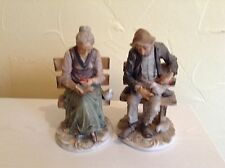 Vintage figurines-old man and woman sitting on benches