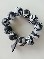 Pulsera elastica blanca y negra / Stretchy black and white bracelet
