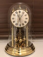 dome clock/torsion mantel/carriage germany working nicely