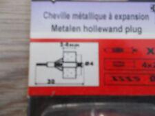 (73A) Lot de 8 chevilles métalliques à expansion (4 x 23) neuves.