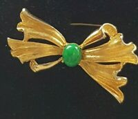 Hollywood gold tone bow  with  Green Art Glass Detail brooch statement piece